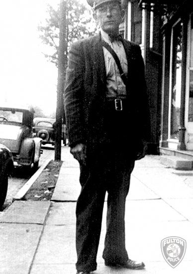 Fulton City Marshal Tom Edson patrol downtown Fulton during the 1930's.</center>