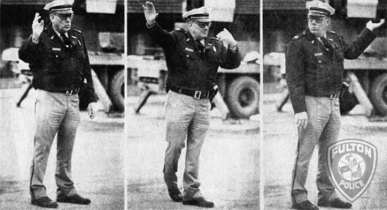 Assistant Police Chief Bill Reifsteck directs traffic at the intersection of Market and 4th Streets in 1979.