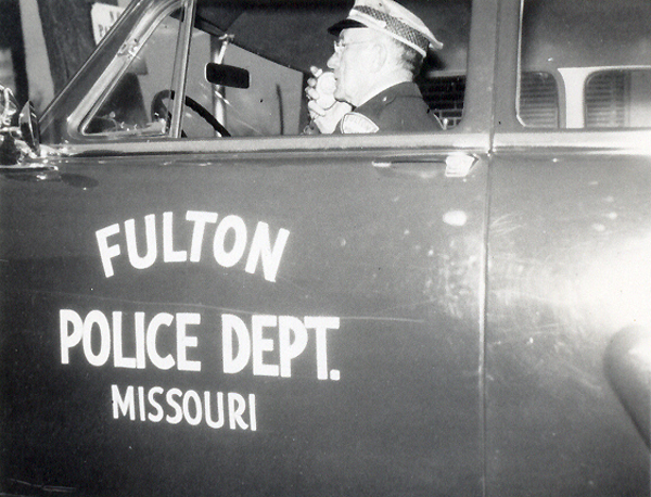 Chief Tom Edson in a Fulton police car.