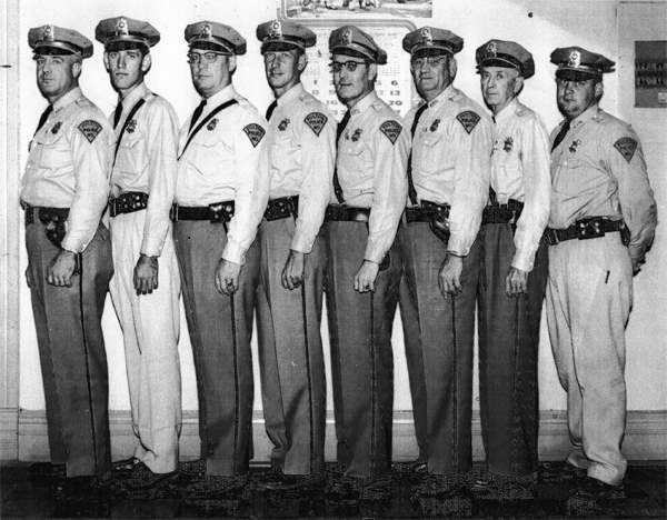 "Members of the Fulton Police Department in 1956. Pictured (left to right): Woodrow ""Woody"" Lewis, Jerry Giboney, Earl Branch, Larry McCray, Russell Maddox. Paul (Sarge) Hilt, Novy Lawrence, James ""Bo"" Wills."