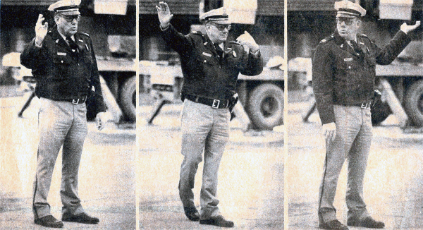 "Assistant Police Chief W.G. ""Bill"" Reifsteck directs traffic at Market Street and 4th Street in 1979."